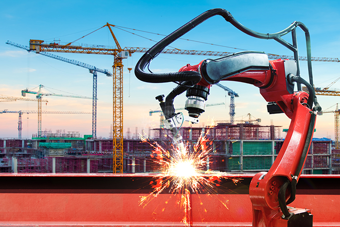 What effect will construction robots have on the demand for skilled labour? [image of robotic welder]